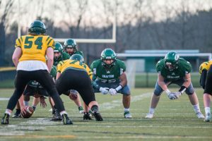 Grafton football linemen line up during a game in Grafton's Fall II season earlier this year.