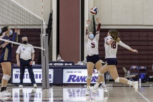 A Westborough girls volleyball players jumps to spike a ball over the net during a game against Shrewsbury earlier this year.