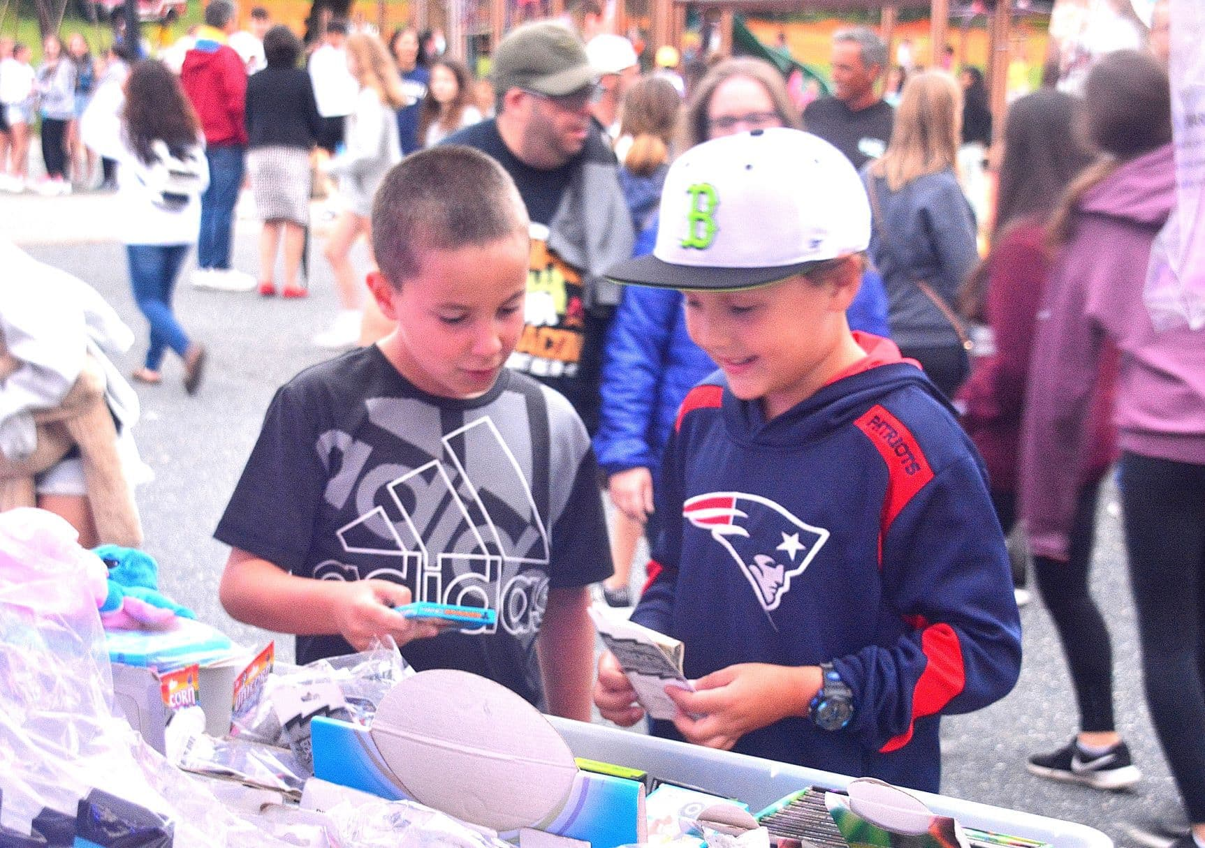 Nine-year-old friends Chris Palleiko and Anthony Leadbeater purchase novelty souvenirs.