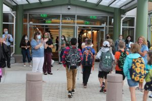Staff applaud as students walk into Beal.