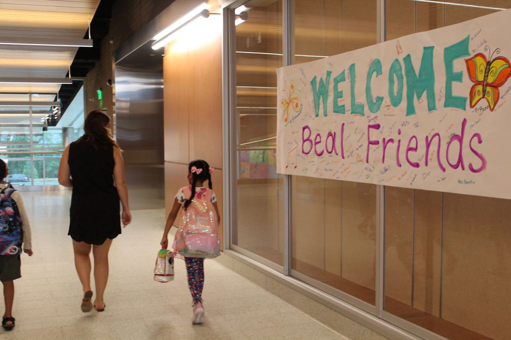 Students make their way to their new classrooms.