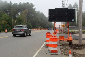 : Cars drive along Route 140 in Boylston. Traffic from a new warehouse in Boylston will use Route 140 road to head to the interstate.   Photo/Laura Hayes