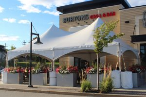 An outdoor dining area sits outside of Burton's Grill and Bar in Shrewsbury.  Photo/Laura Hayes