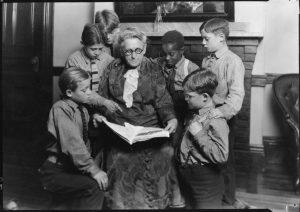 The boys gather around a teacher at the Lyman School for Boys.