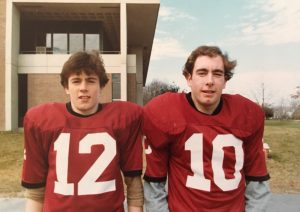 Mike and Tom Power stand side-by-side outside of Westborough High School.
