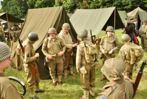 Reenactors gather prior to this year's Battle for the Airfield reenactment in Hudson.