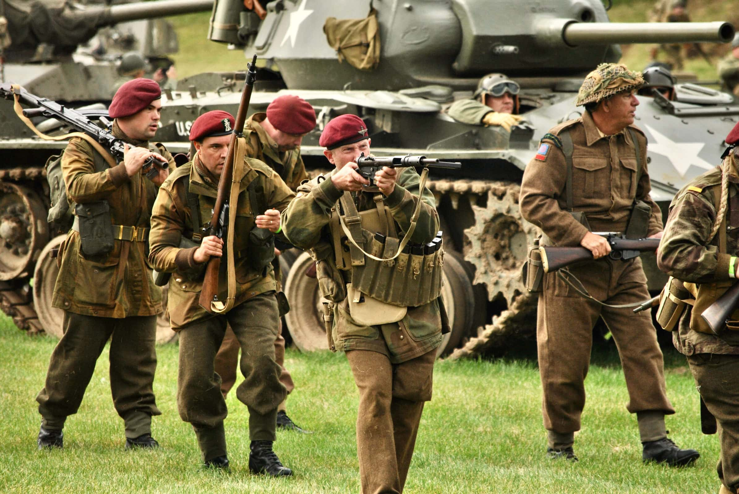Reenactors take their positions during this year's Battle for the Airfield reenactment at the American Heritage Museum in Hudson.