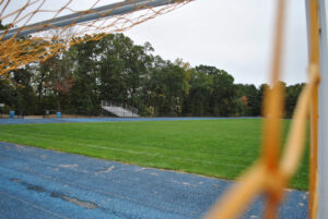 Part of the Marlborough High School campus is viewed through the netting of a soccer goal. Marlborough boys soccer ended last week strong with a 3-0 defeat of Groton Dunstable.  Photo/Dakota Antelman