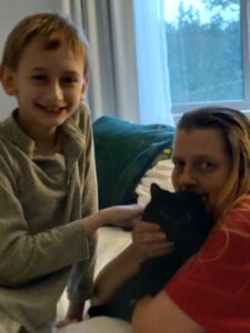 Leelan and Lisa pose with Leelan's cat, Rosie. A firefighter retrieved Leelan's cat following the fire that tore through their building at 129 Maple St. in Northborough last month.