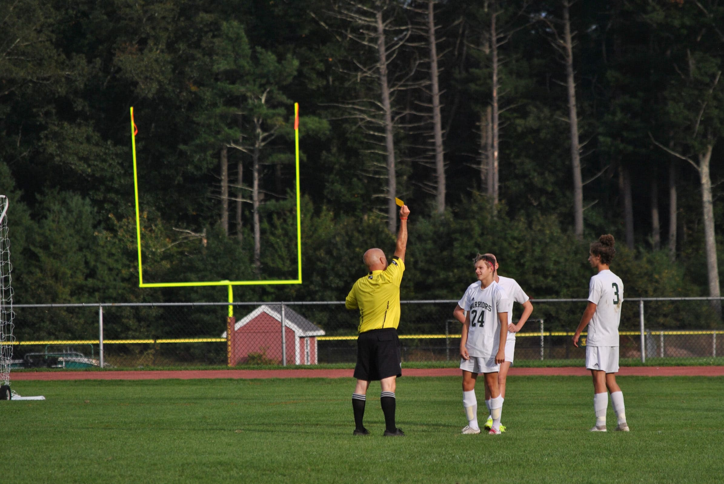A referee issues a yellow card during a physical and penalty-filled first half of Algonquin's game against Tantasqua on Oct. 9.