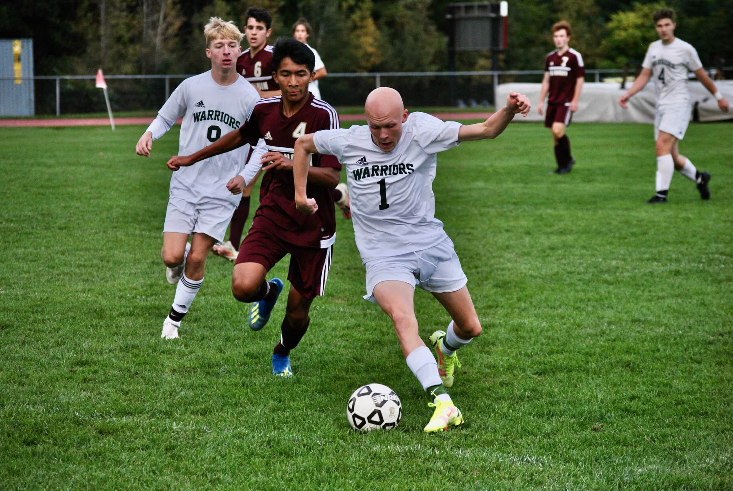 Algonquin players give chase as Tantasqua's Owen O'Brien dribbles upfield.