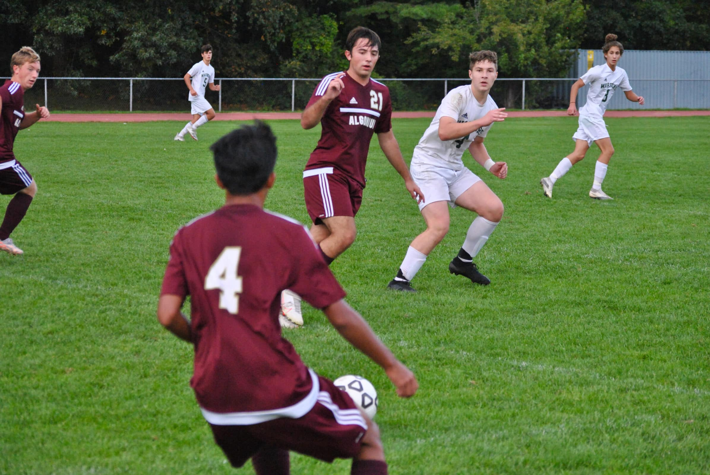 Algonquin's Keenan Siao eyes his options while holding possession at midfield against Tantasqua.