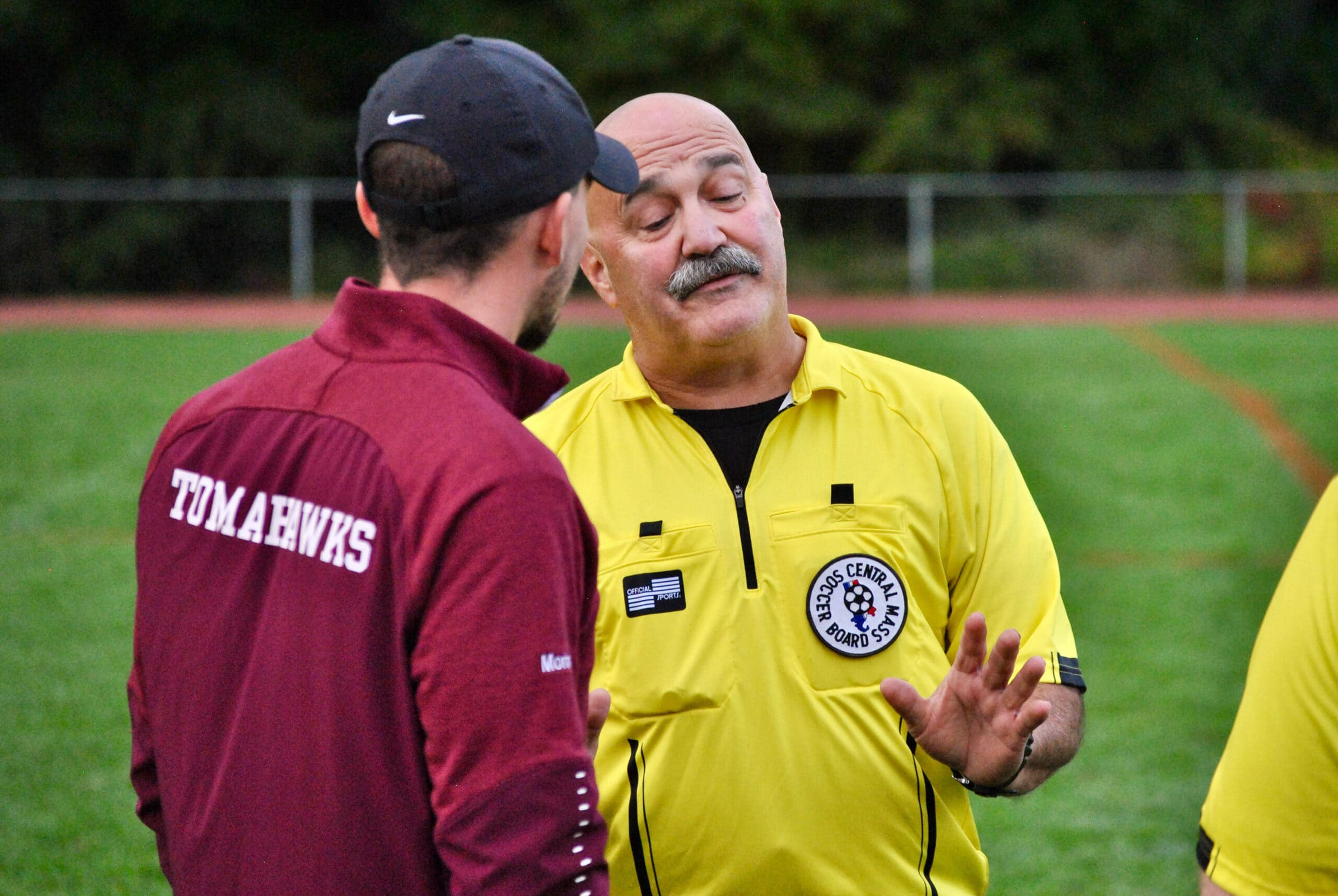 An Algonquin coach debates a series of first half calls with an official during halftime of his team's game against Tantasqua on Oct. 9.