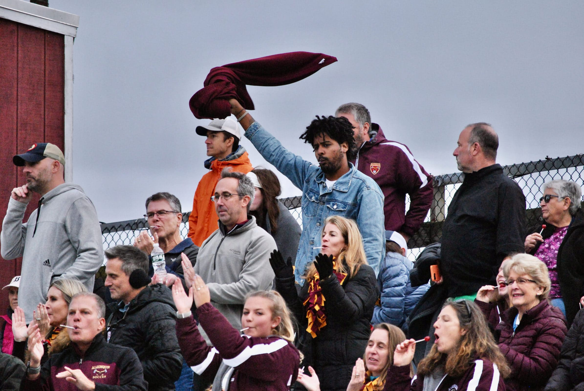 Algonquin fans celebrate a goal by their team late in their game on Oct. 9.