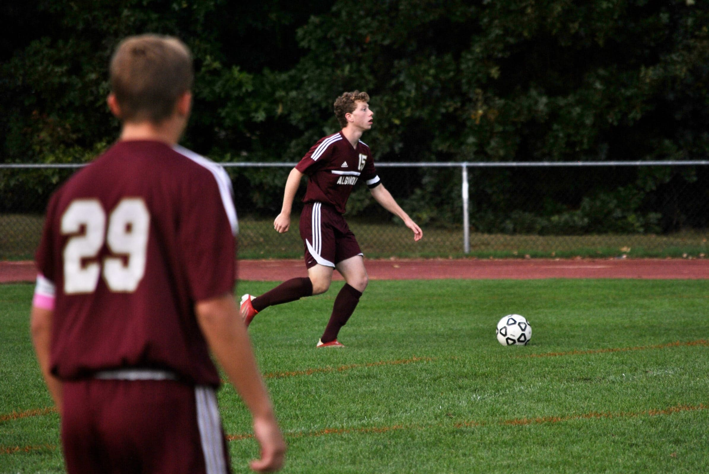 Josh Kopstein dribbles the ball up the field while he is watched by teammate Ethan Connolly during a recent game.