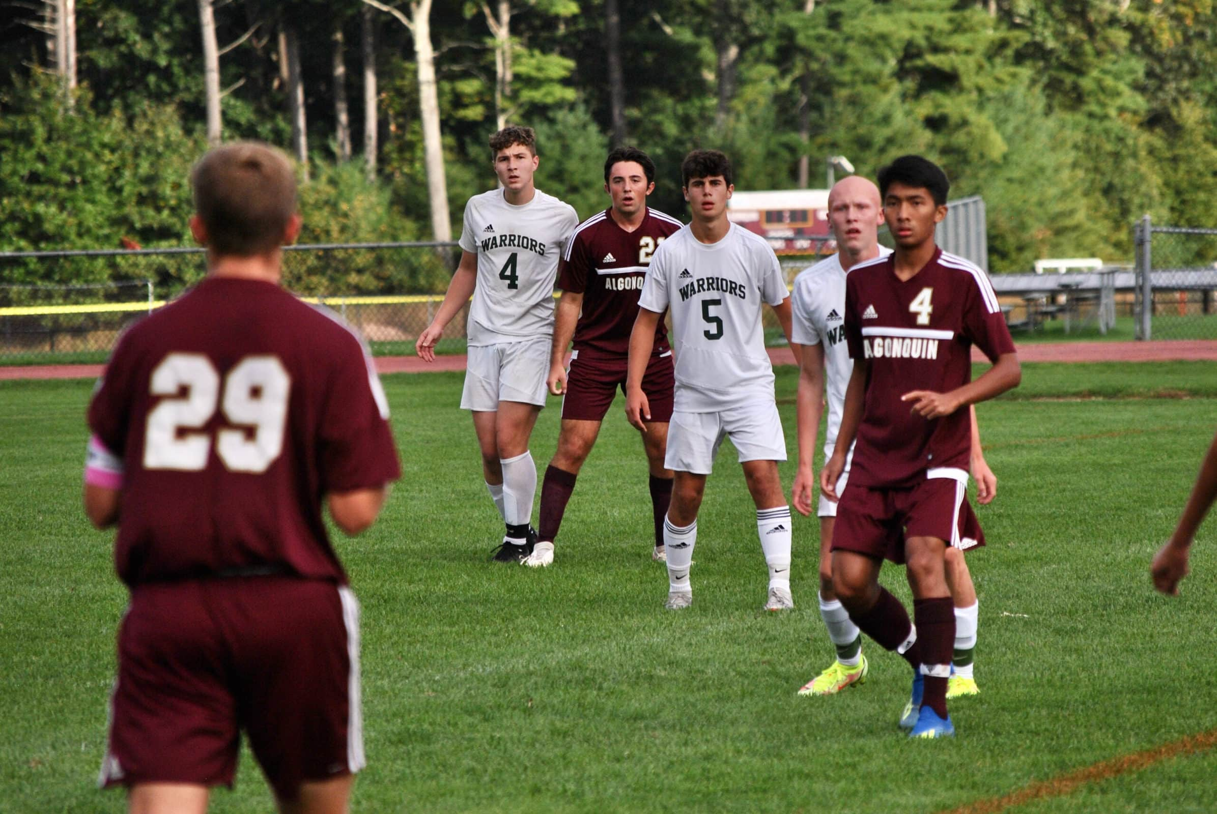 Ethan Connolly eyes teammates to target off a throw in.
