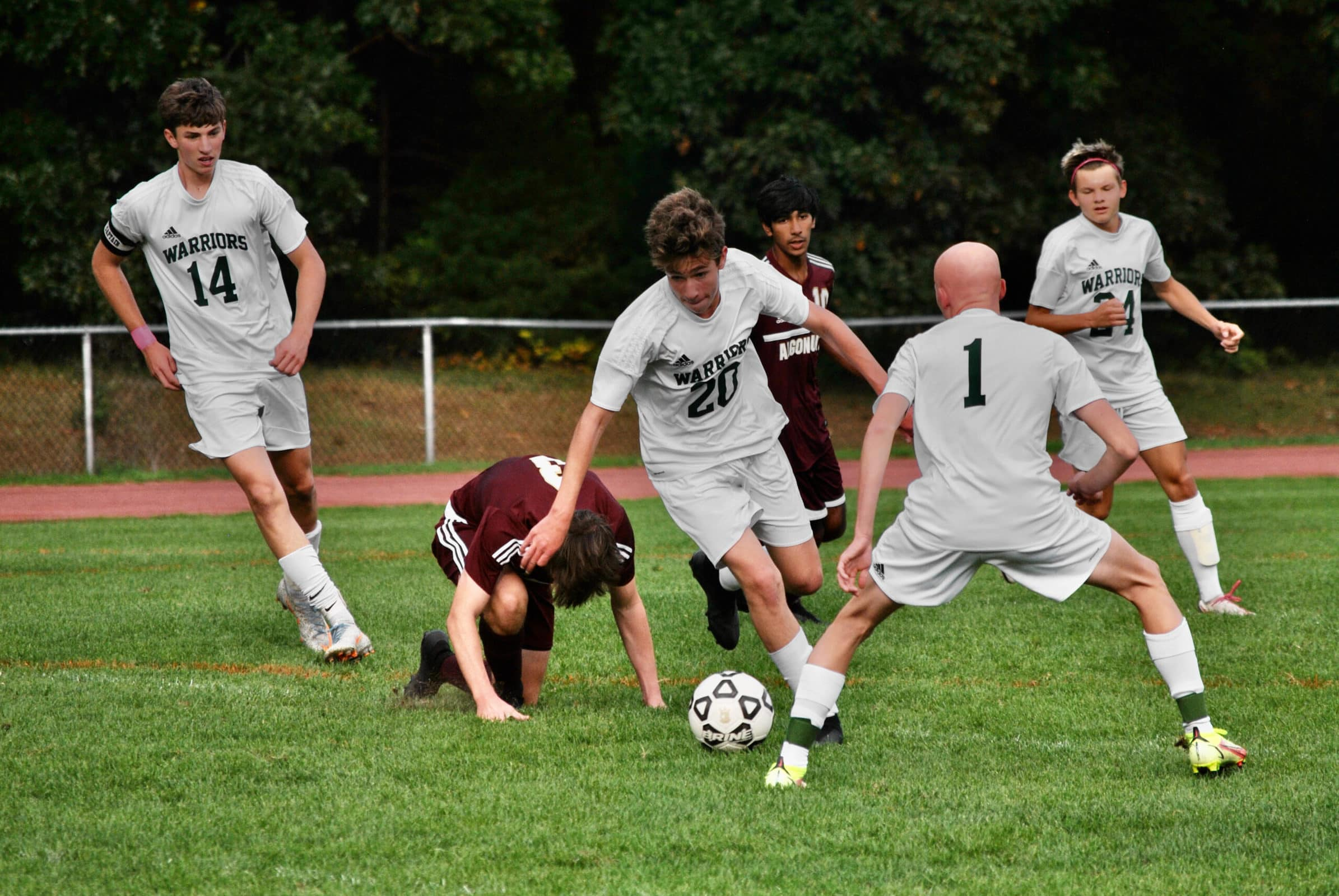 Tantasqua players charge towards Algonquin's goal after knocking down Algonquin's Conor Hoolahan.