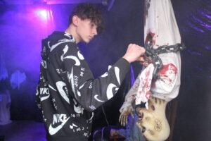 Derek Shimer adjusts decorations before the Halloween Haunt opens.   Photos/Laura Hayes