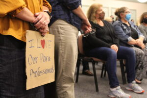 An attendee holds a sign during a recent Shrewsbury School Committee meeting.