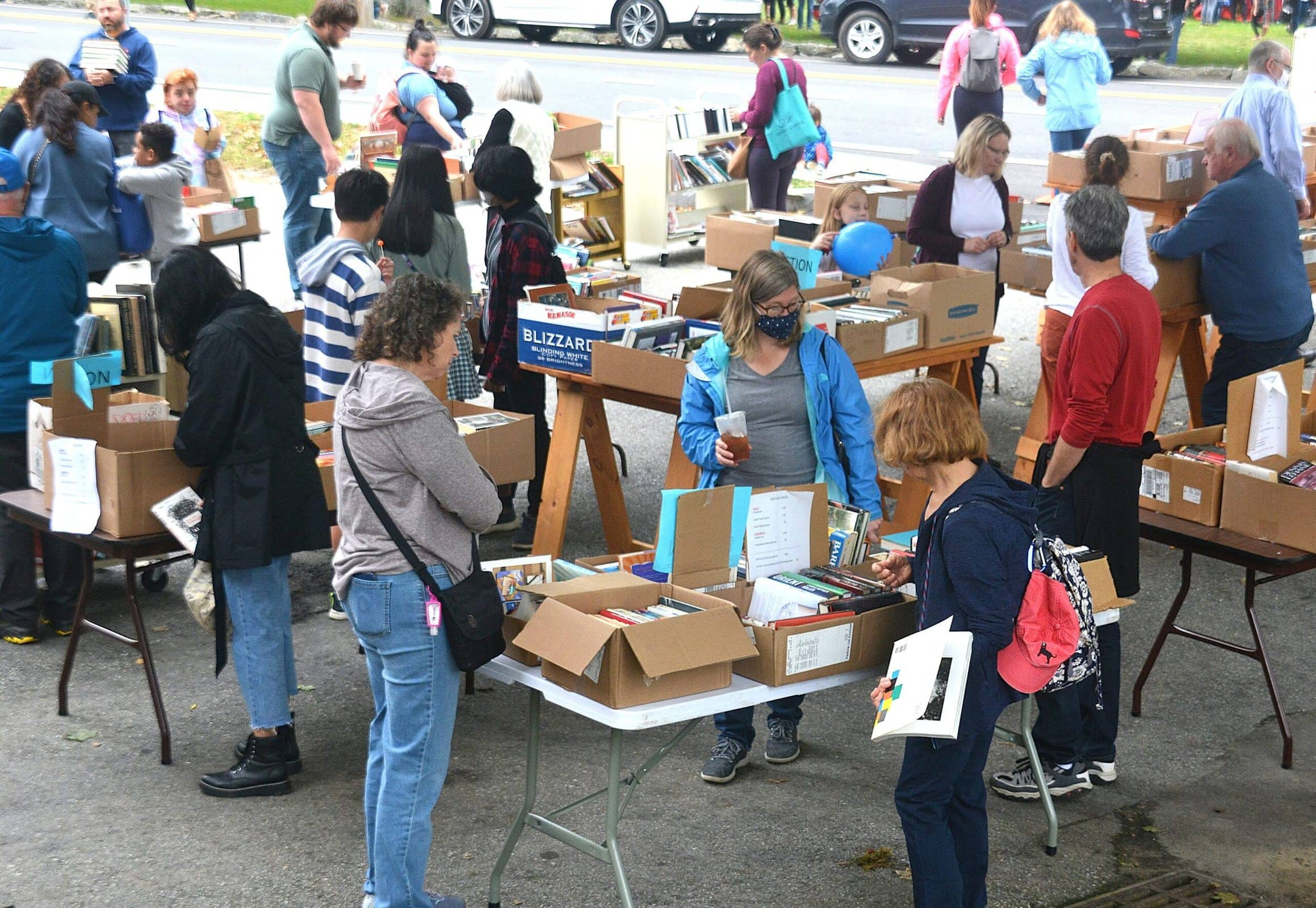 Shoppers browse the book sale fundraiser offered by the Friends of the Southborough Library.