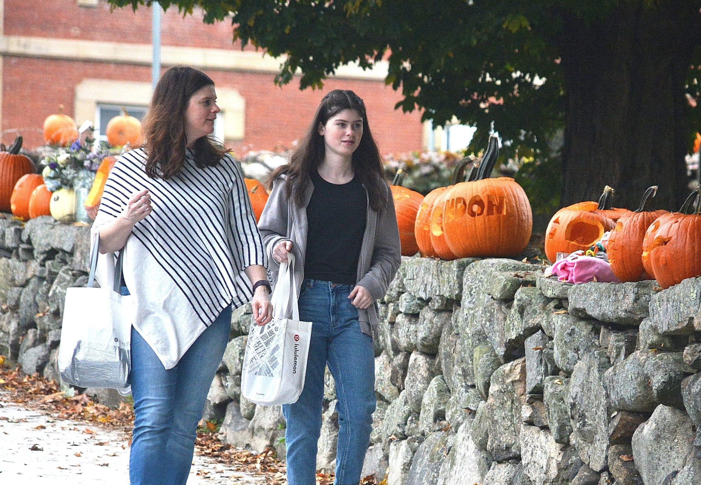 Jennifer Peoples and her daughter Madeline, a Trottier Middle School eighth-grader, view Pumpkin Stroll entries along Common Street.