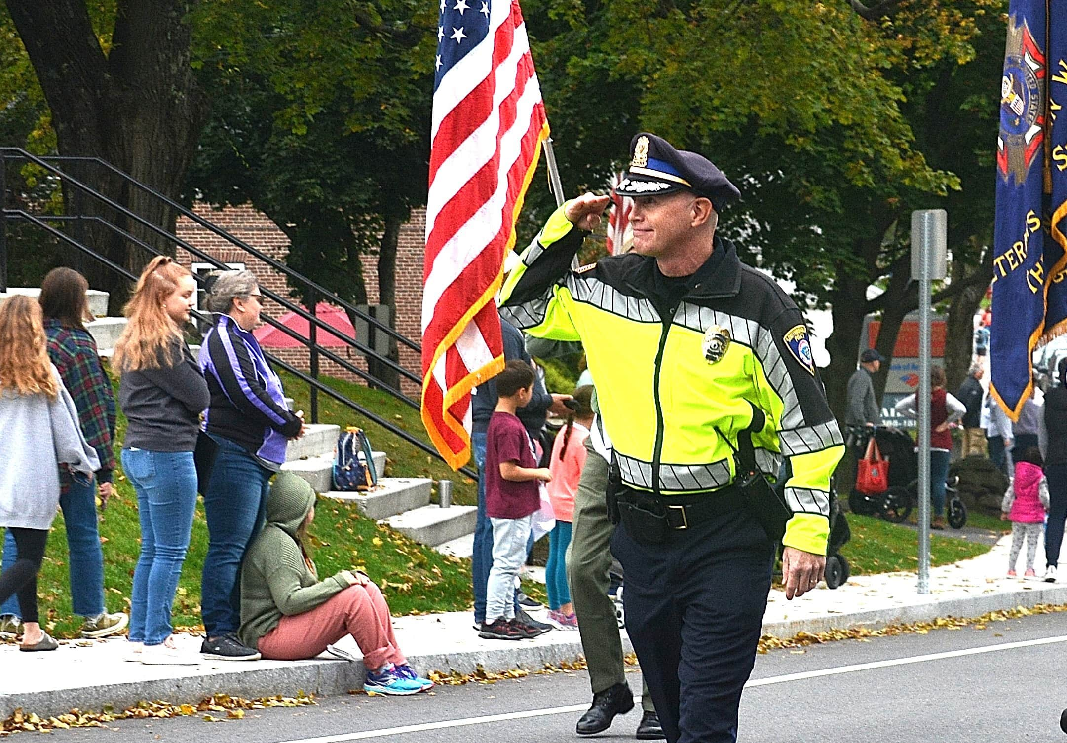 Police Chief Kenneth Paulhus salutes as he leads the Southborough Heritage Day parade.