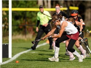 Algonquin Regional High School's Juliet Chapin (#5, front) scores the first of her three goals in front of Marlborough High School's Jennifer Mague (#5, behind Chapin) and Ashley Thebado (GK, behind Mague).