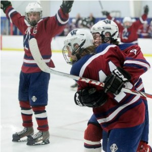 Westborough High School's Brian Bernard (#11, front left), is congratulated by his teammate Kevin Blackney (#8, right rear) after tying the game 1-1 in the second period.
