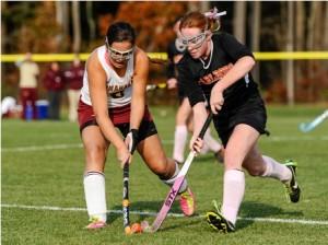 Algonquin Regional High School's Carolyn Sacco (#6, left) battles Marlborough High School's Megan Mayfield (#9, right) for control of the ball.