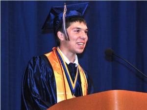 Valedictorian Stephen Munzer jokes with his classmates.