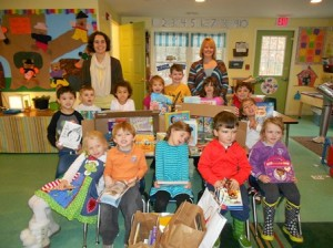 Photo: Students at Miss Tanya's Woodland School with some of the books they collected. (Photo/submitted)