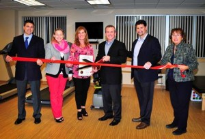 (l to r) State Rep. Matthew  Beaton, R-Shrewsbury, State Rep. Danielle Gregoire, D-Marlborough, ActiveRX owners Julie and Paul Reilly, ActiveRX CEO Matt Essex, and Corridor Nine Area Chamber of Commerce President Barbara Clifford celebrate ActiveRx's grand opening with a special ribbon cutting ceremony Oct. 23. (Photo/submitted)
