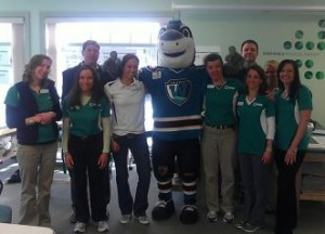 Owner Jon Dooley, MSPT, with several of the Greendale Physical Therapy team members and Worcester Sharks mascot, Finz