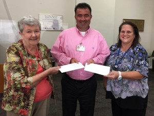 (l to r) Theresa Banfield of the Marlborough Hospital Auxiliary's Well Wishes Gift Shop; Steven McCue, hospital chief financial officer; and Auxiliary President Susan Weber Photo/submitted