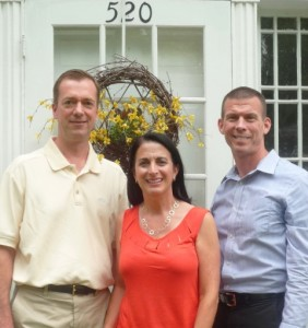 (l to r) Jim and Susan Collins and John Demac, owners of Collins & Demac Real Estate. Photo by Nancy Brumback