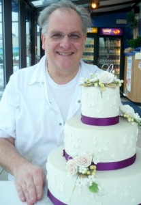 Jon Lundstrom with a model of a wedding cake Photo/Nancy Brumback