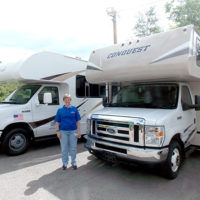 Sheri Fuller with two RVs from the fleet. Photo/Valerie Franchi.