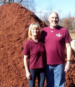Sue and Roger McCarthy with a mountain of mulch at their headquarters Photo/Nancy Brumback