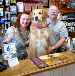 Sandie and Ken Wheeler, and their golden retriever, Tori, the store's chief tasting officer. Photo/Nancy Brumback