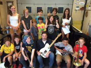 Jack Shanahan, center, and music students at Jack's Guitar Garage Photo/submitted