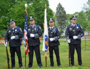 Officers of the Shrewsbury Police Department stand at attention during the Shrewsbury Memorial Day Services. Photo/Joyce DeWallace