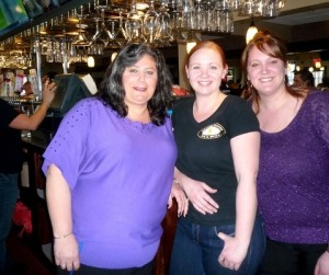 (l to r) left to right, Katarina Fotiadis-Rajotte, owner of the Draught House, with Nikki Benoit, bar manager; and Andrea Rotolo, sales director, pose for a photo in the all new bar, which features over 30 beer taps.  Photos/ Nancy Brumback