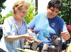 Karen Villani and Sherri Chapman shop for antique kitchenware.