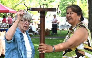 Sheila Dickman and Linda Casey examine an antique coatrack
