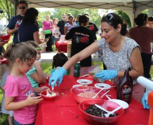Maria Murdock, Apple Tree Arts board member serves ice cream at last year's the Community Ice Cream Social. (Photo/submitted)