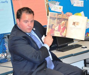 """State Rep. David Muradian, R-Grafton, reads """"The Matchbox Diary"""" to fifth-graders."""