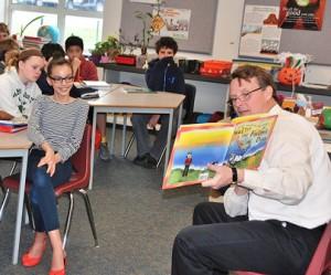 State Sen Michael Moore, D-Millbury, reads to sixth-graders.