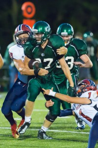 Several Westborough players attempt to tackle Grafton's Matt O'Brien (#27)