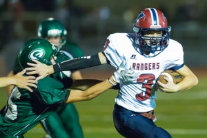 Westborough's Jack Cerny (#3) evades a tackle by Grafton's Connor Driscoll