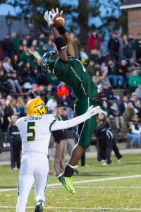 Grafton's Ifeatu Melifonwu leaps skyward as he tries to catch a pass in the end zone.